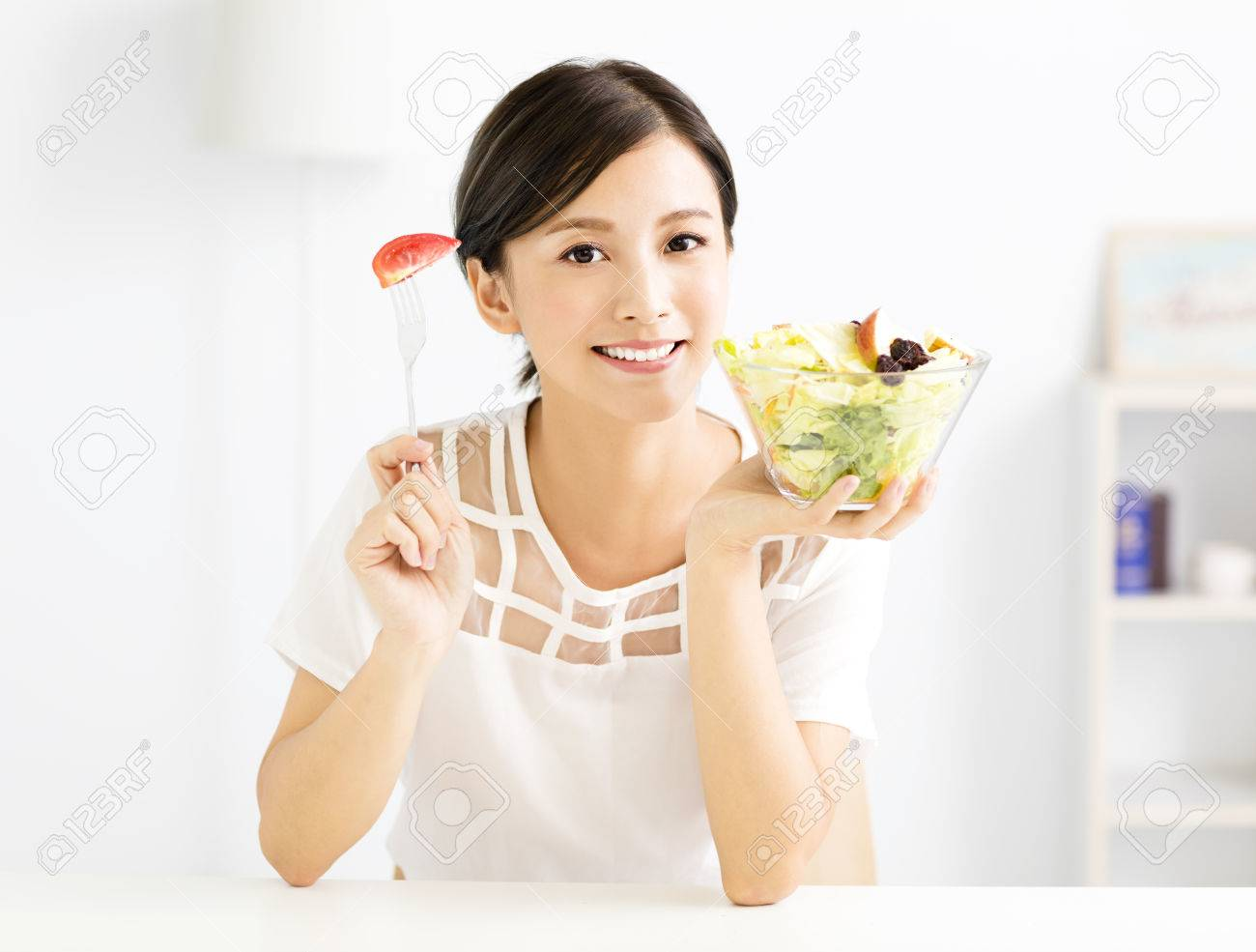 beautiful young woman eating healthy food - 63240222