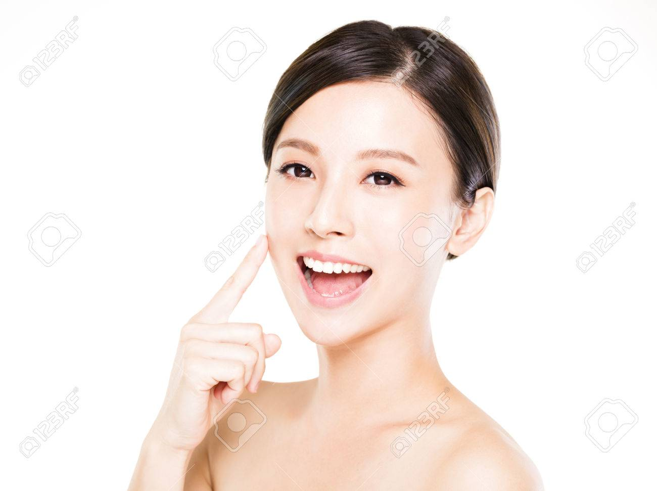 closeup young woman face with clean skin - 63240506