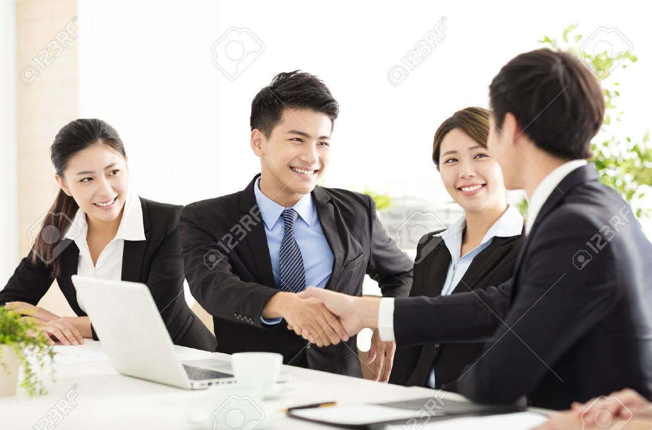 business people shaking hands during meeting - 63240658