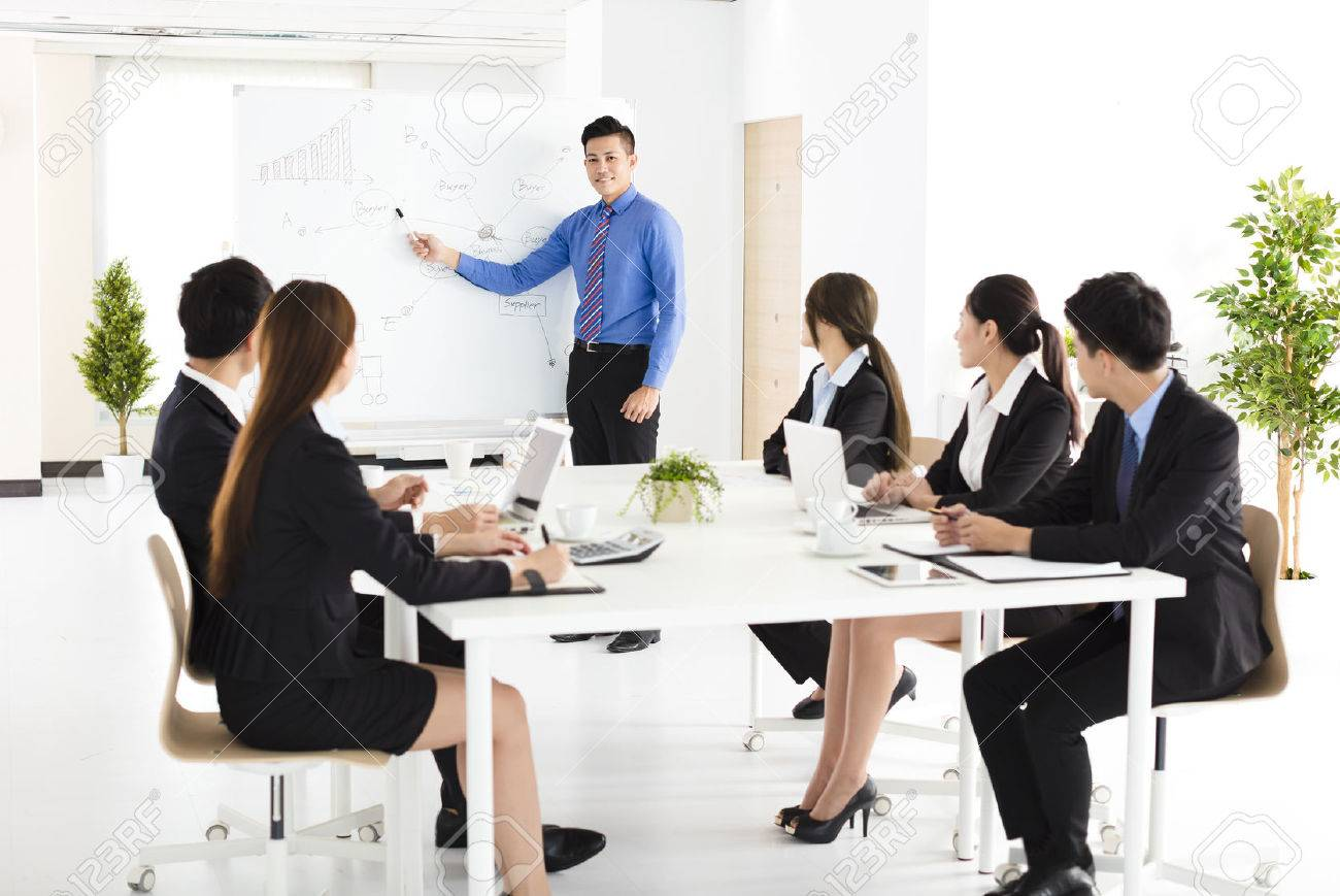 Businessman presenting new project to partners in office - 63240671