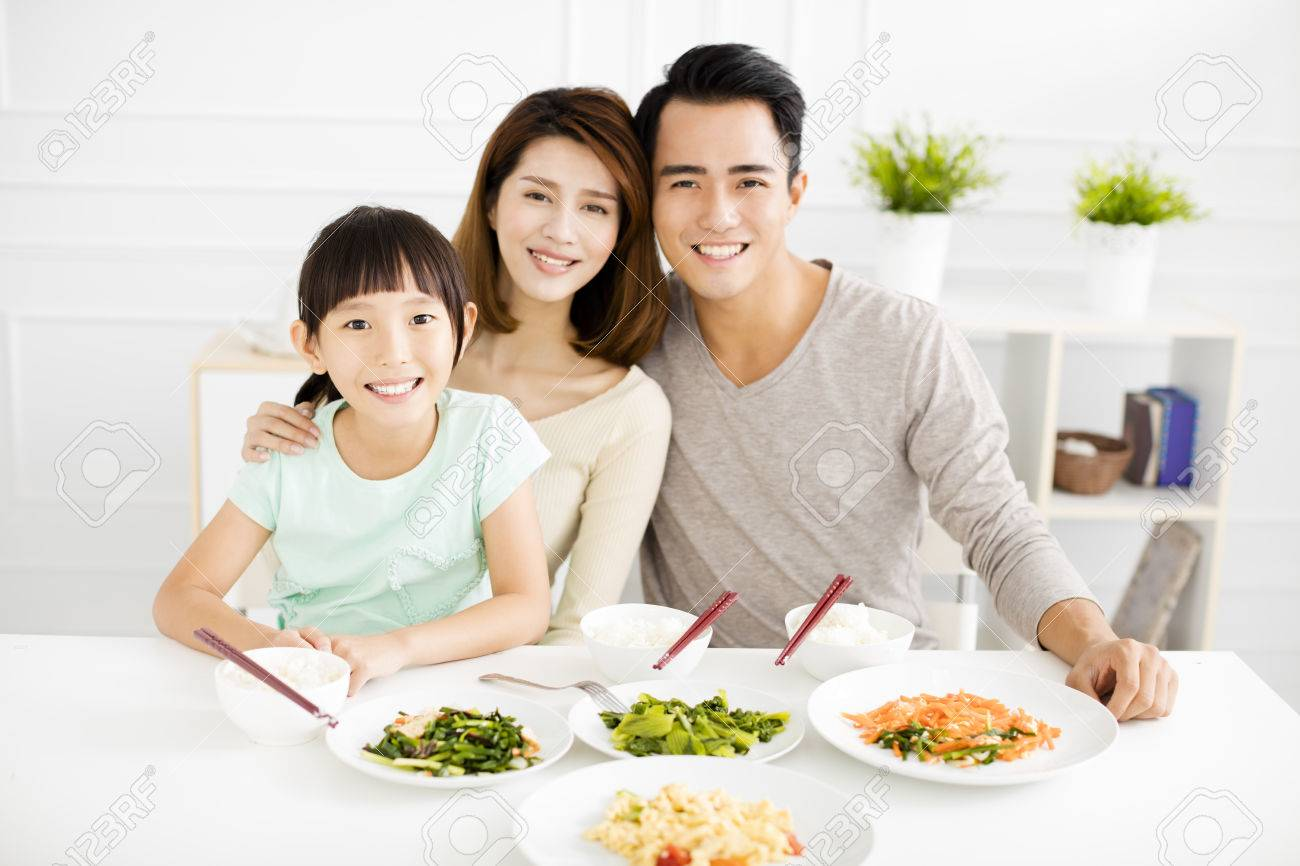happy asian young Family enjoy their dinner - 65825571