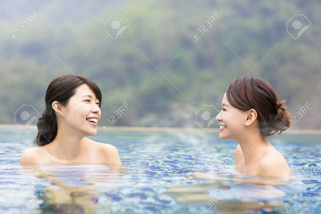 happy young woman relaxing in hot springs - 66159571
