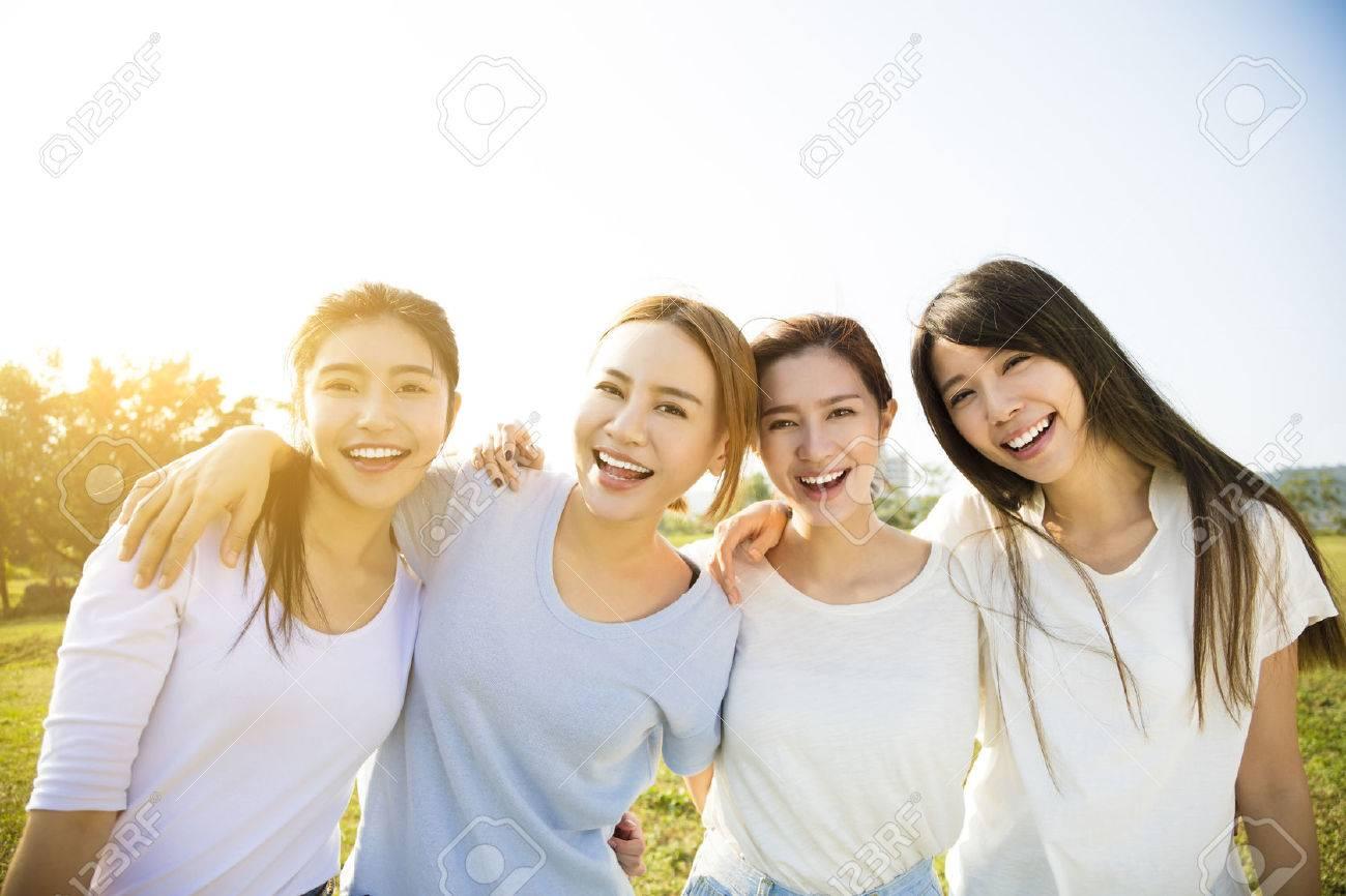 Group of young beautiful women smiling - 69328863