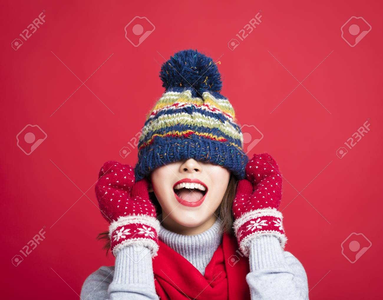 Happy Young Beautiful Woman in winter clothes - 88279213