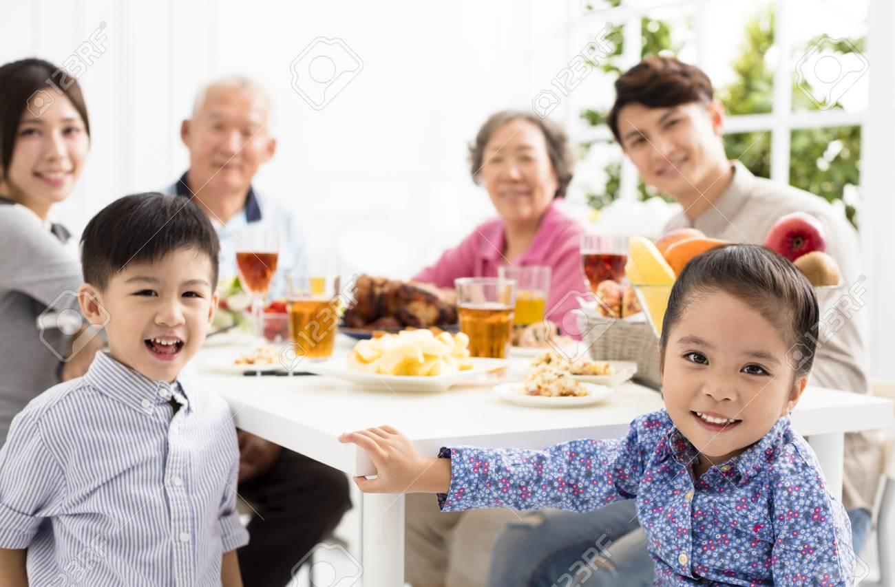 happy asian family having dinnerat home - 89509935