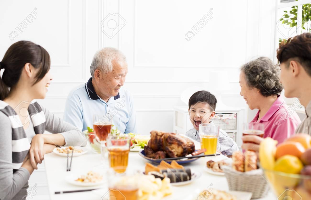 happy asian family having dinnerat home - 89666023