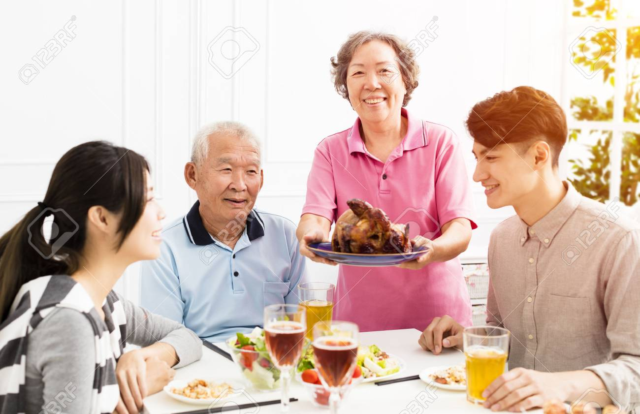 Happy family having dinner together - 89770502