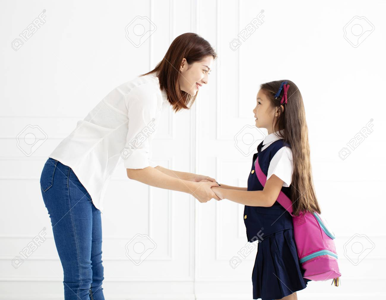 Mother holding hand of daughter ready go to school - 102387740
