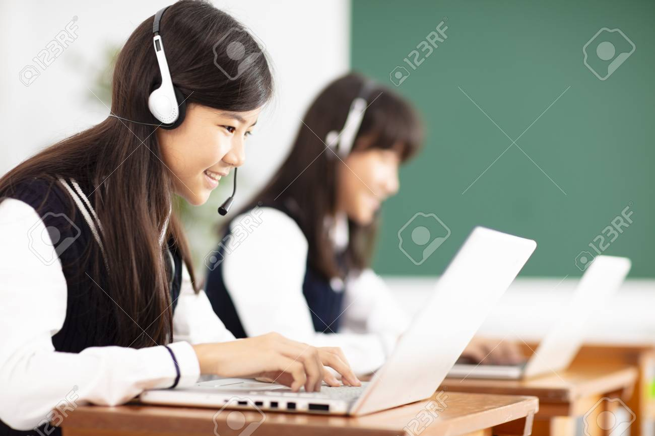 teenager student learning online with headphones and laptop - 103467671