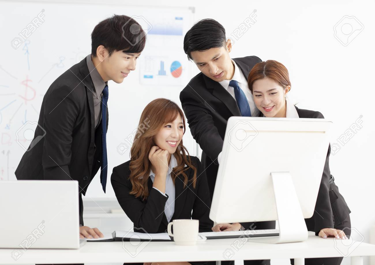 young business team discuss in office - 106014177