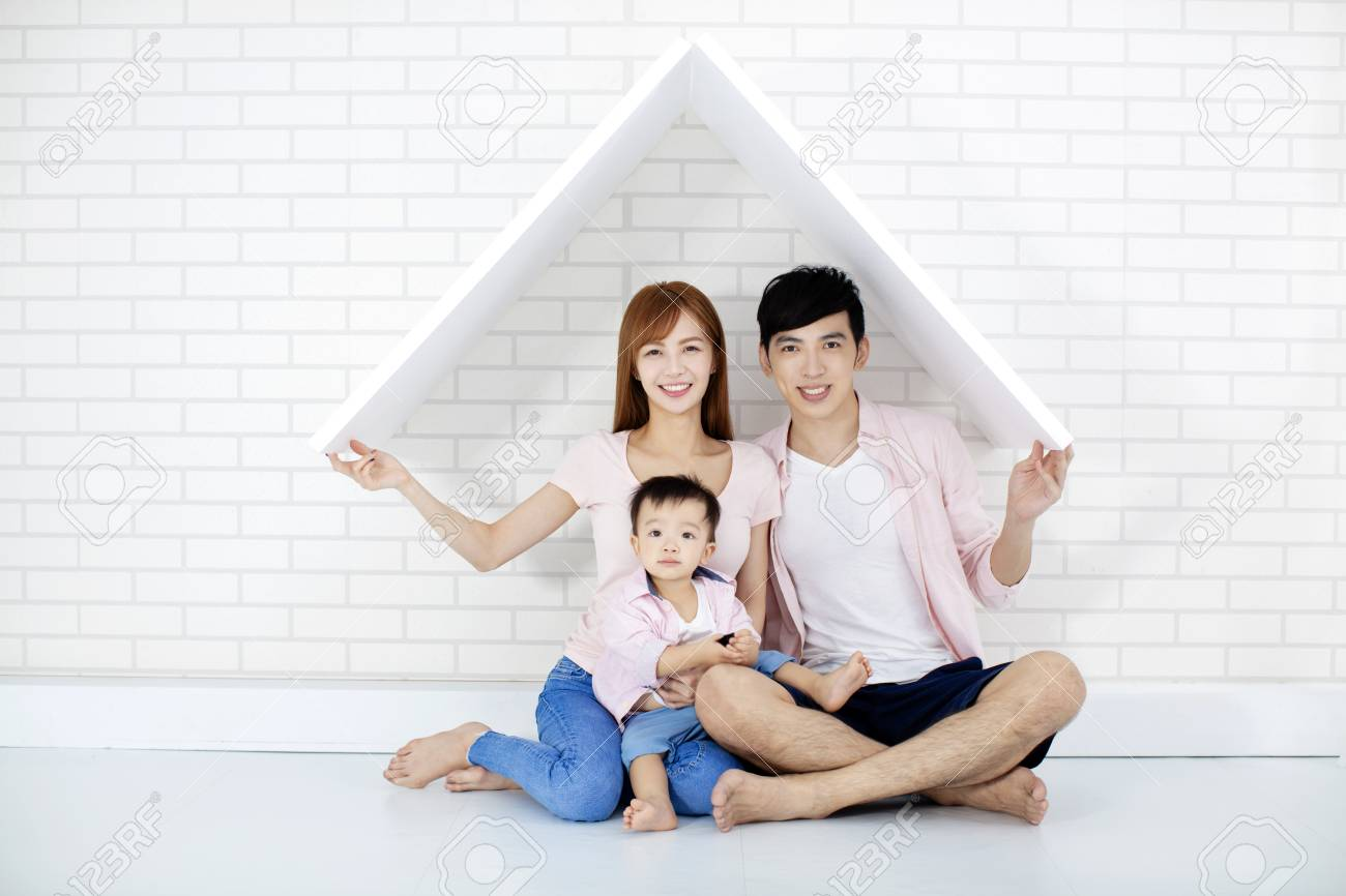 happy family in new house with roof - 109213058