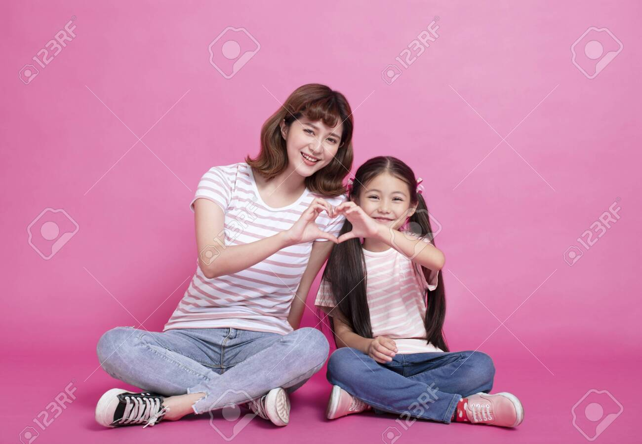 happy mother and child making hand heart - 121167671