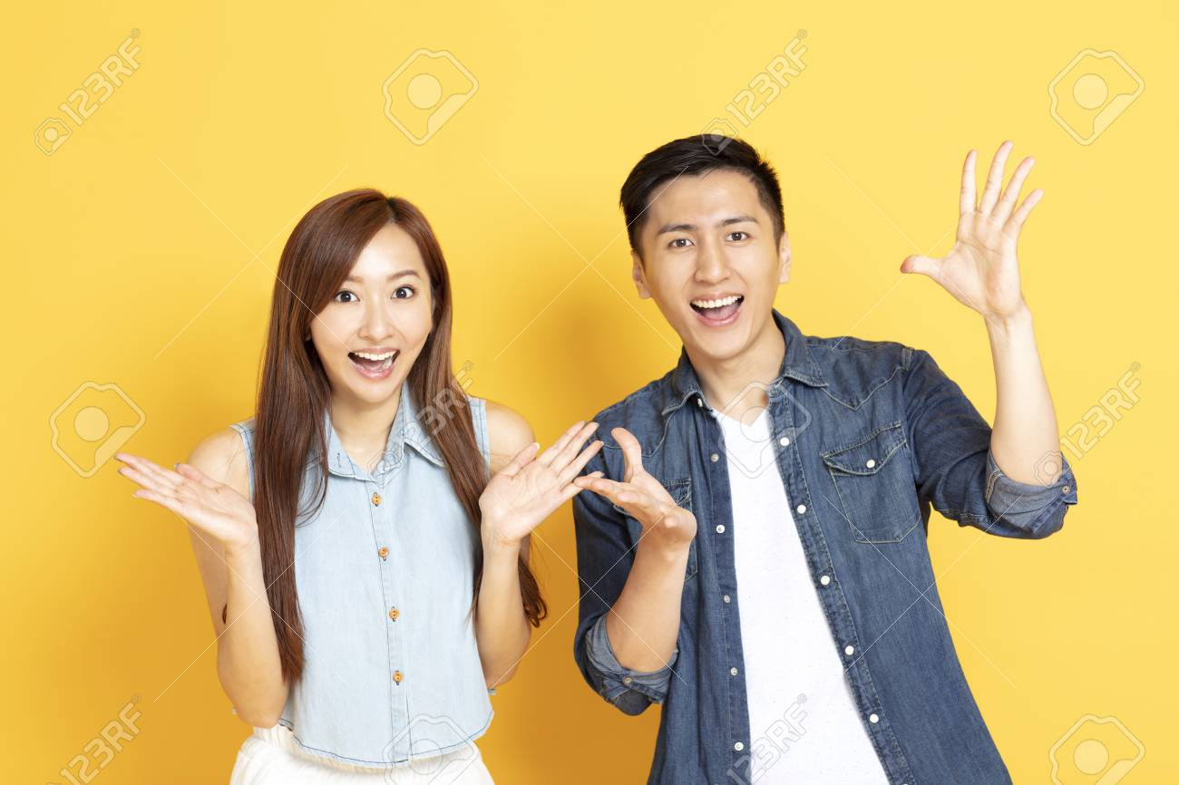 surprised Asian young couple in summer casual clothes - 123608734