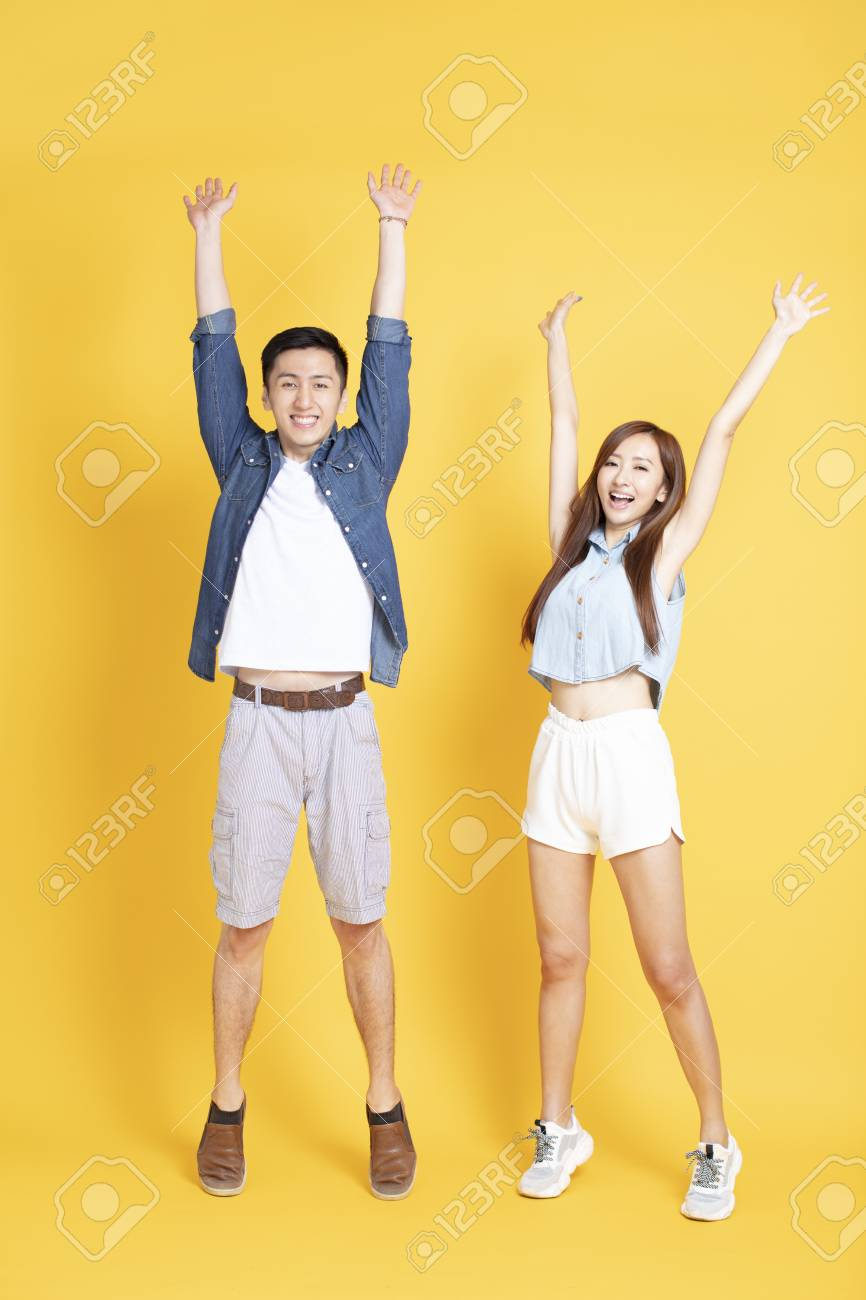 happy young couple in summer casual clothes celebrating - 123846343