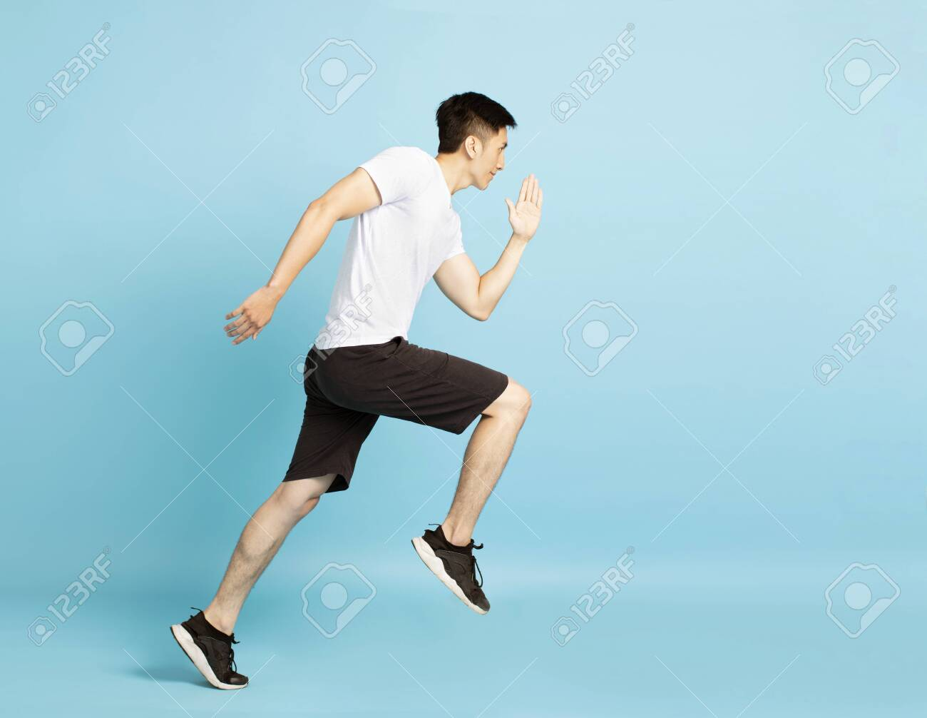 Full length portrait of young fitness man running - 124842614