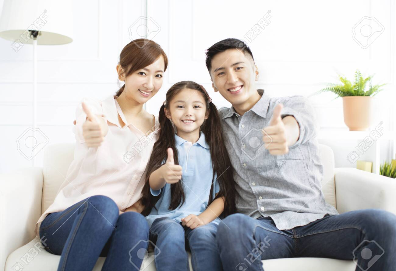 Happy parents and child having fun together - 125122231