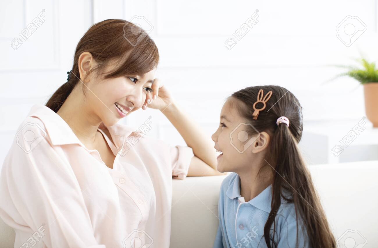 happy mother talking with little girl at home - 125110828