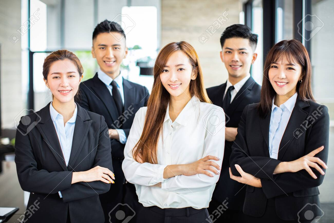 confident asian business team stands in office - 127105515
