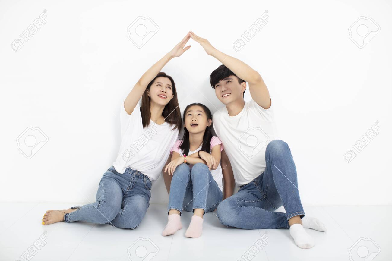 happy young family sitting on floor with home concept - 129608025