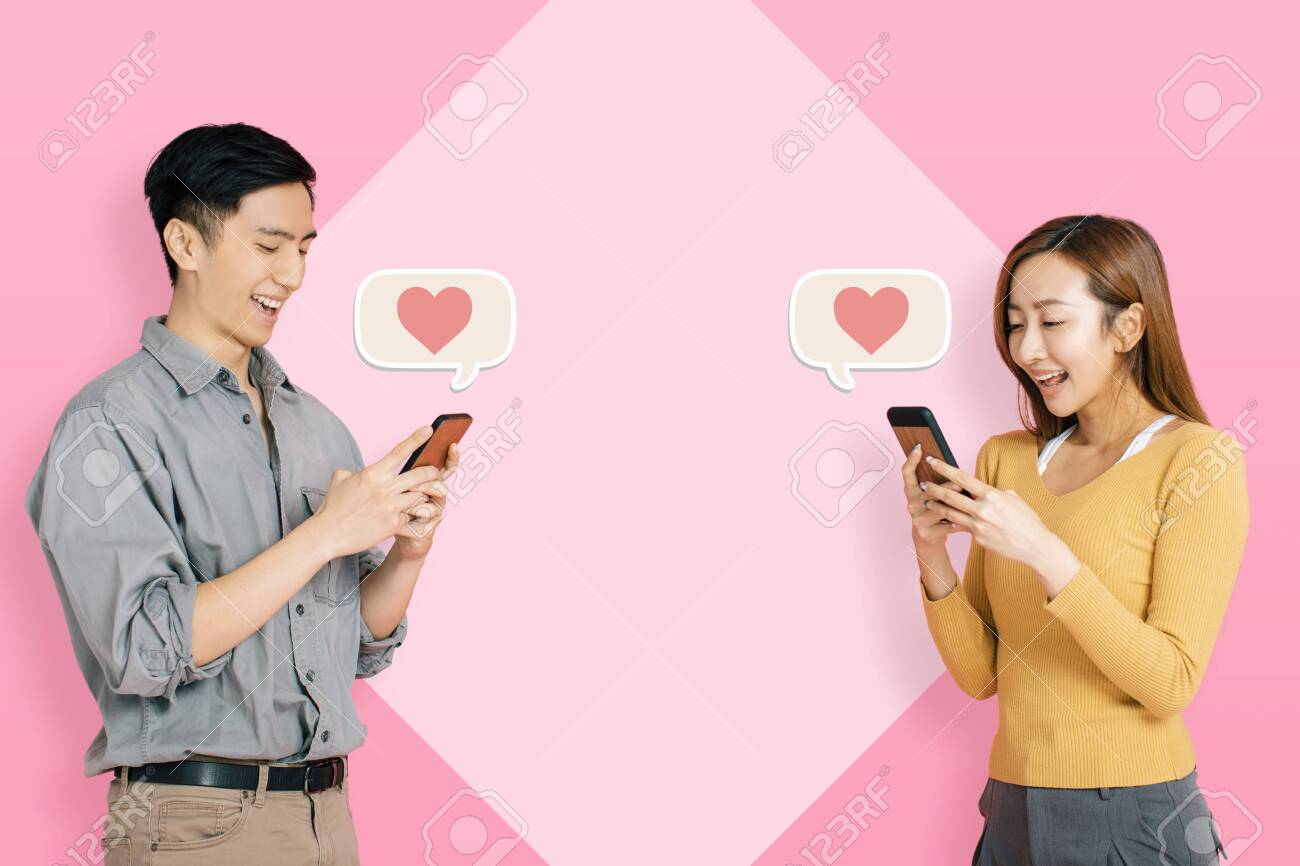Young happy couple using mobile app to connect and instant messaging - 134719667