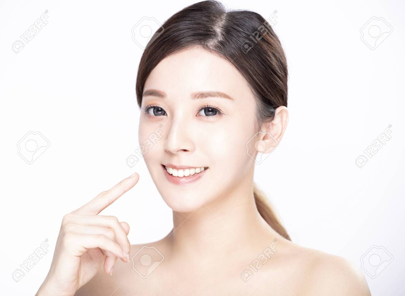 closeup young beauty face and showing her teeth - 137654198