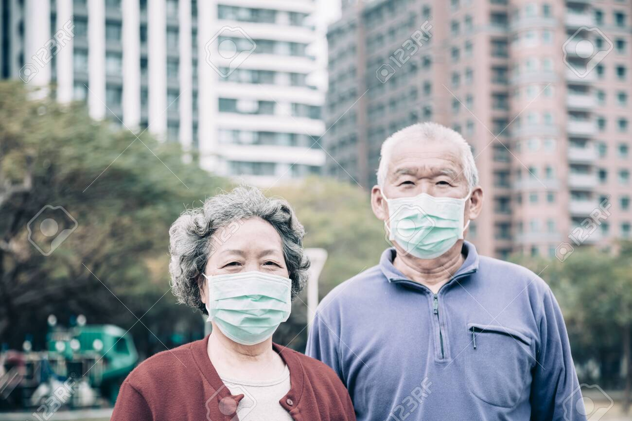 senior couple wear with protective face mask - 140186173