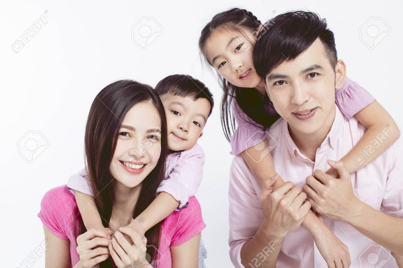 Young parents piggybacking their two kids - 142118271