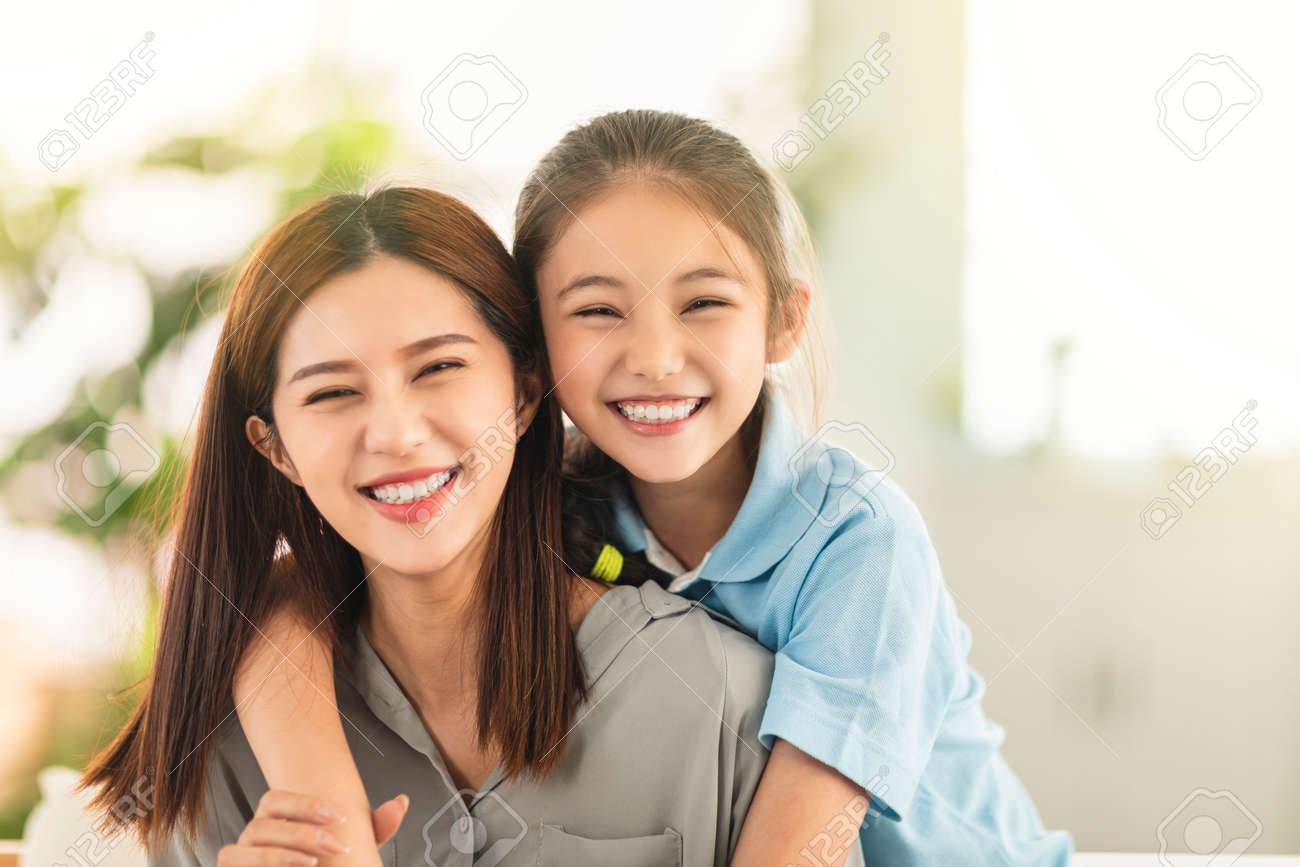 Happy mother and little girl daughter having fun at home - 166646238