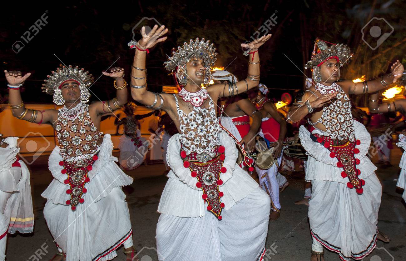 Ves Dancers (Up Country dancers) perform during the Esala Perahera in Kandy, Sri Lanka. The Esala Perahera is held to honour the Sacred Tooth Relic of Lord Buddha which is enshrined within the Temple of the Sacred Tooth Relic - 64768399