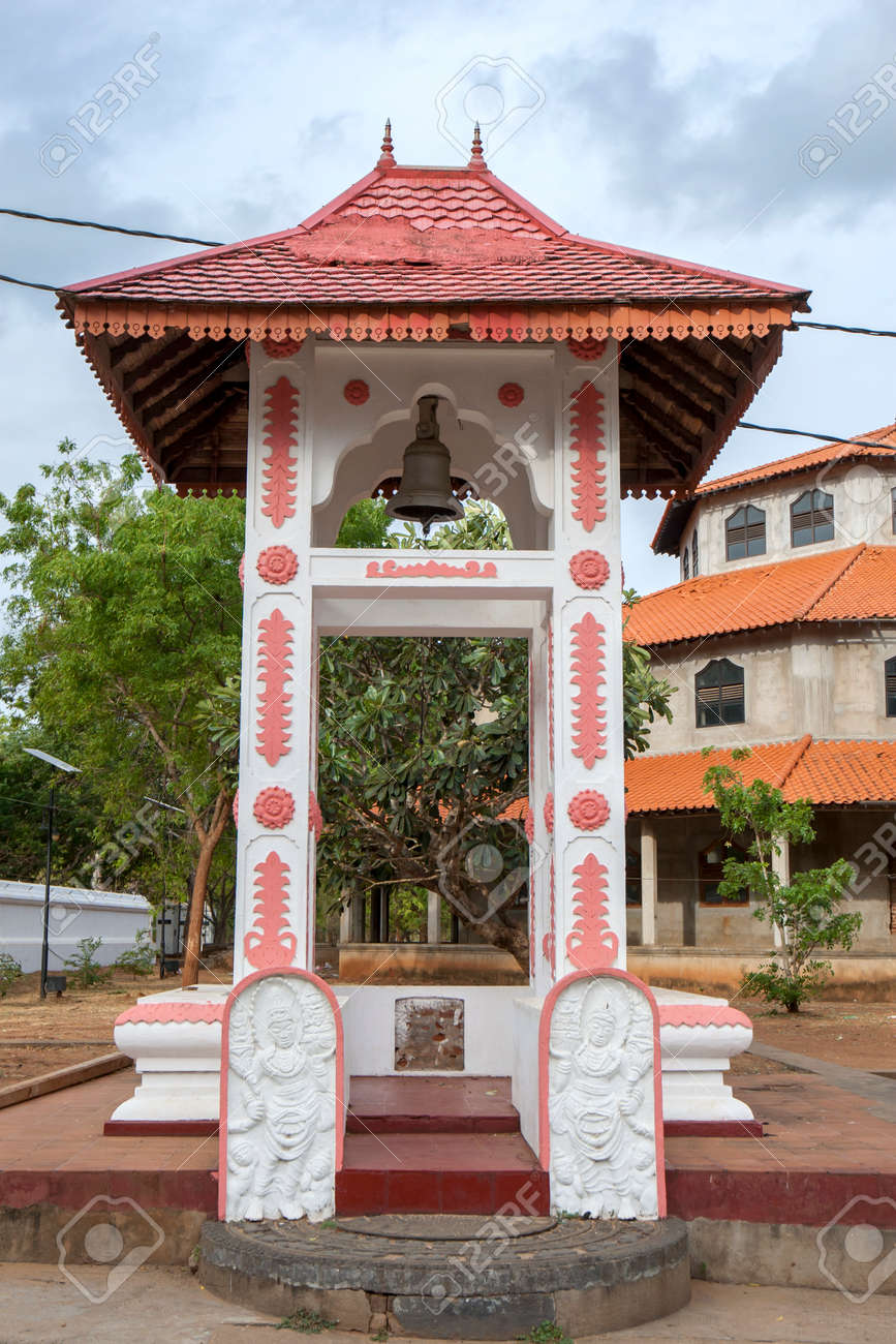 A Buddhist Bell Tower featuring guardstones and a moonstone entrance at the ancient site of Kataragama in southern Sri Lanka. - 171122482