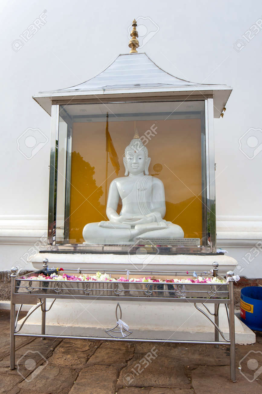 A Buddhist Shrine standing in front of Kiri Vihara, a dagoba that dates back to the 1st century BC at the ancient site of Kataragama in southern Sri Lanka. - 171122485