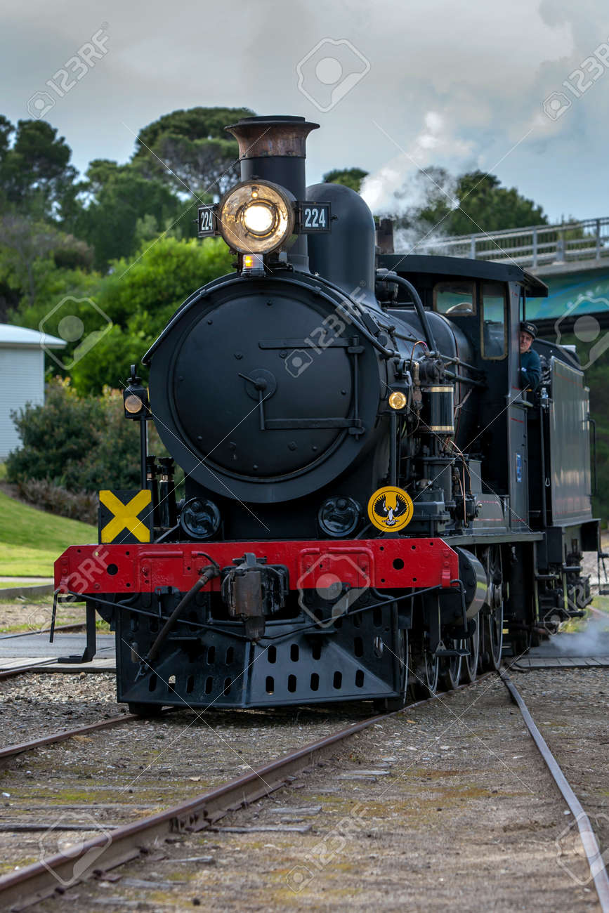 Engine RX 224, a 1915 built steam locomotive, prepares to connect to the Cockle Train at Goolwa station in South Australia, Australia. The train is run by the SteamRanger Heritage Railway. - 171834614
