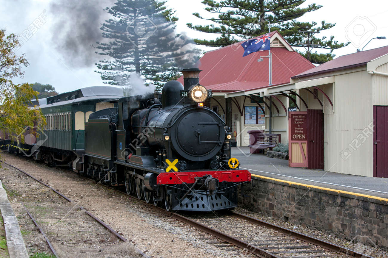 The Cockle Train driven by RX 224, a 1915 built steam locomotive, arrives at Port Elliot station in South Australia, Australia. The train is run by the SteamRanger Heritage Railway. - 171834616