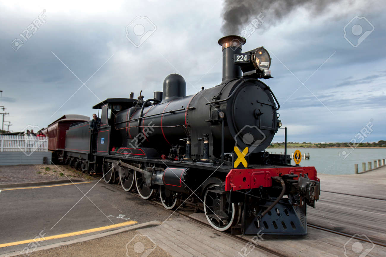 The Cockle Train driven by RX 224, a 1915 built steam locomotive, departs Goolwa station in South Australia, Australia. The train is run by the SteamRanger Heritage Railway. - 171834617