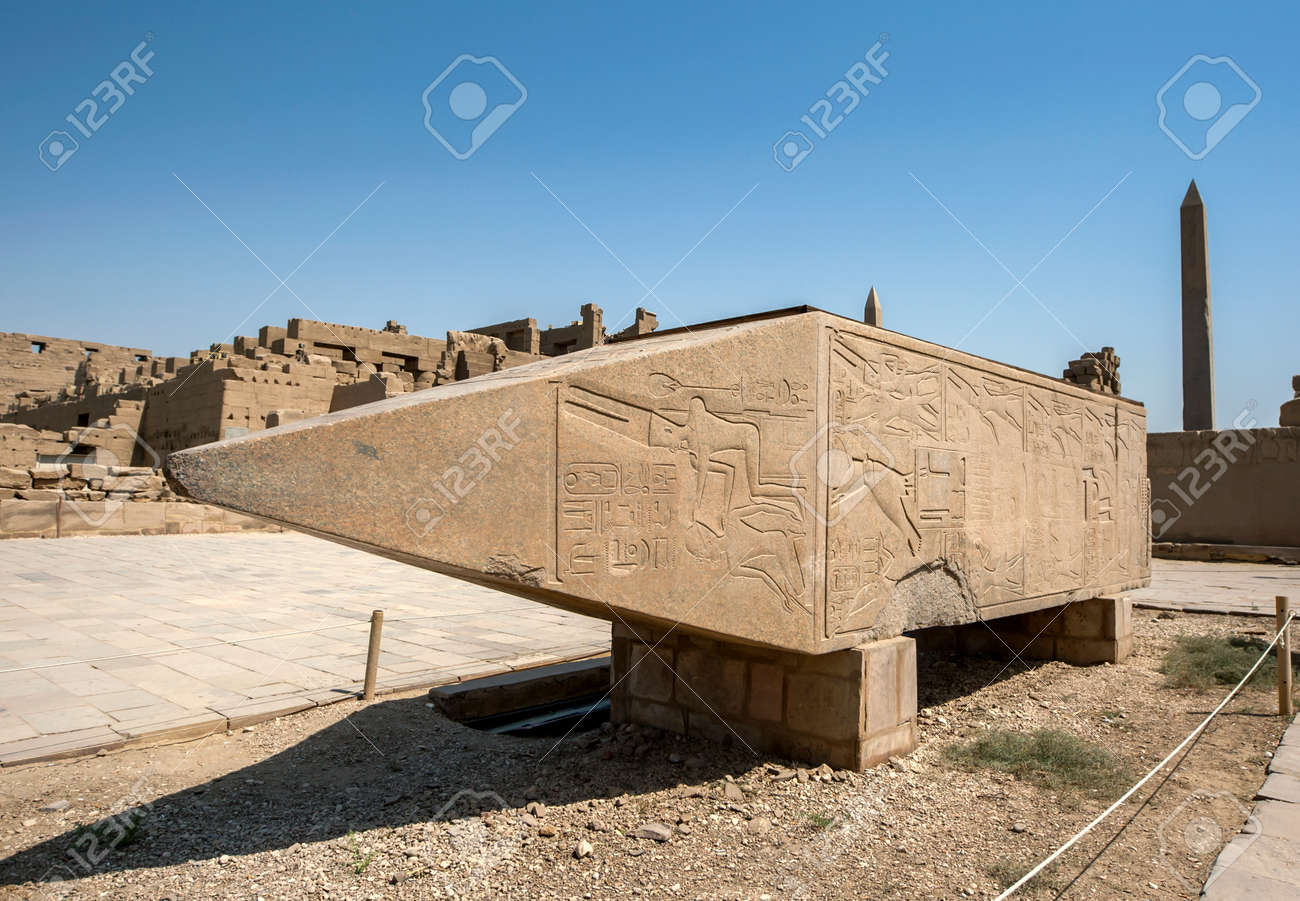 The upper section of the pink granite obelisk of Hatshepsut adjacent to the Sacred Lake at Karnak Temple (Great Temple of Amun) at Luxor in Egypt. - 172089074