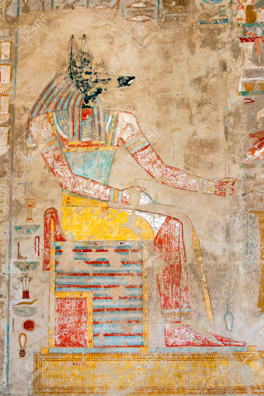 A relief depicting a seated Anubis, the canine (jackal) God of the Dead, at the Mortuary Temple of Hatshepsut at Deir al-Bahri near Luxor in central Egypt. - 172089027