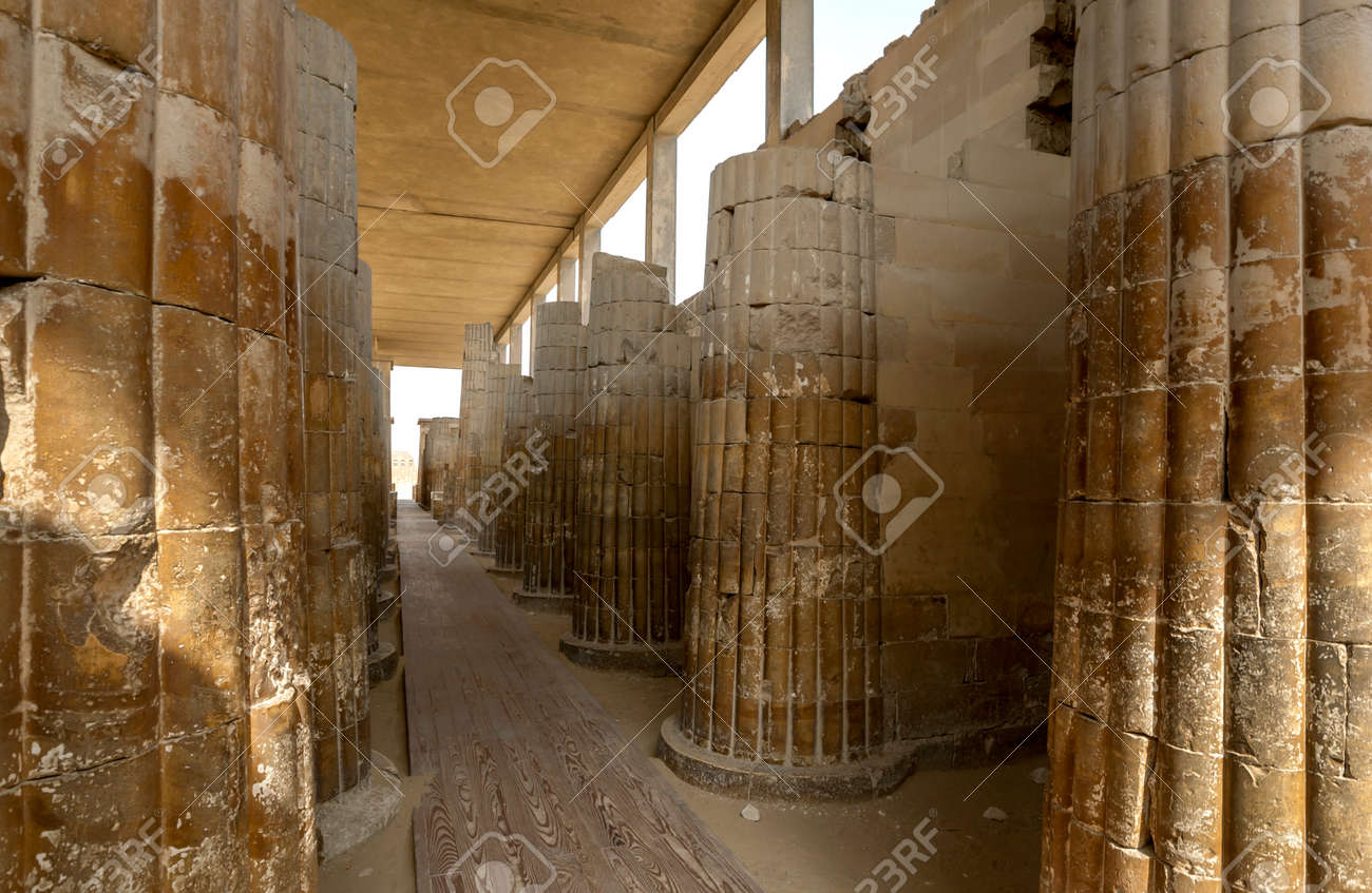 The stone carved columns of the Hypostyle Hall at the entrance to the Step Pyramid (Pyramid of Djoser) at Saqqara in northern Egypt. - 172089025
