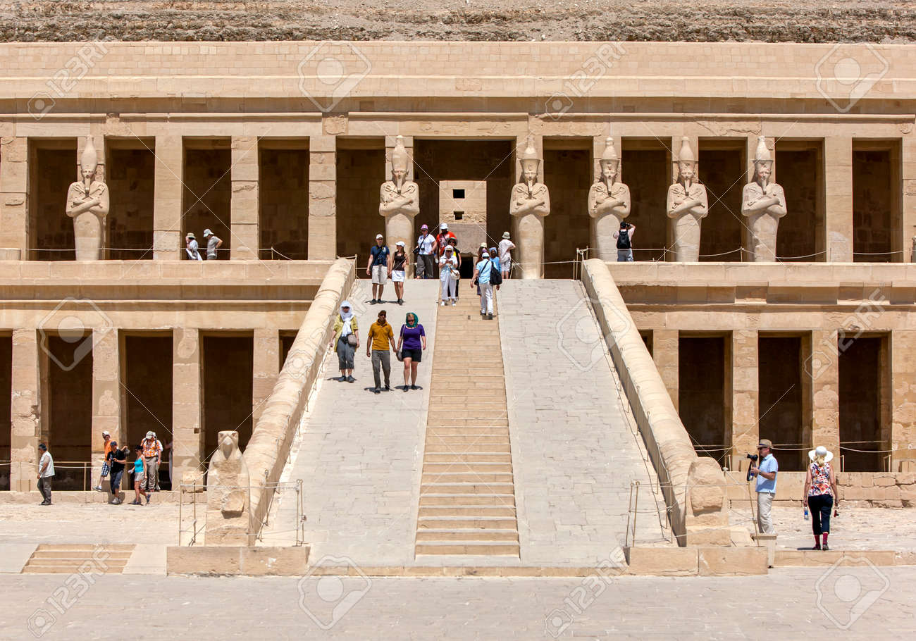 LUXOR, EGYPT - MAY 05, 2013 : The Mortuary Temple of Hatshepsut including a row of Osiris pillars which stand along the upper terrace at Deir al-Bahri near Luxor in central Egypt. The temple was built by Queen Hatshepsut (1473- 1458BC) as a funerary monum - 172089024