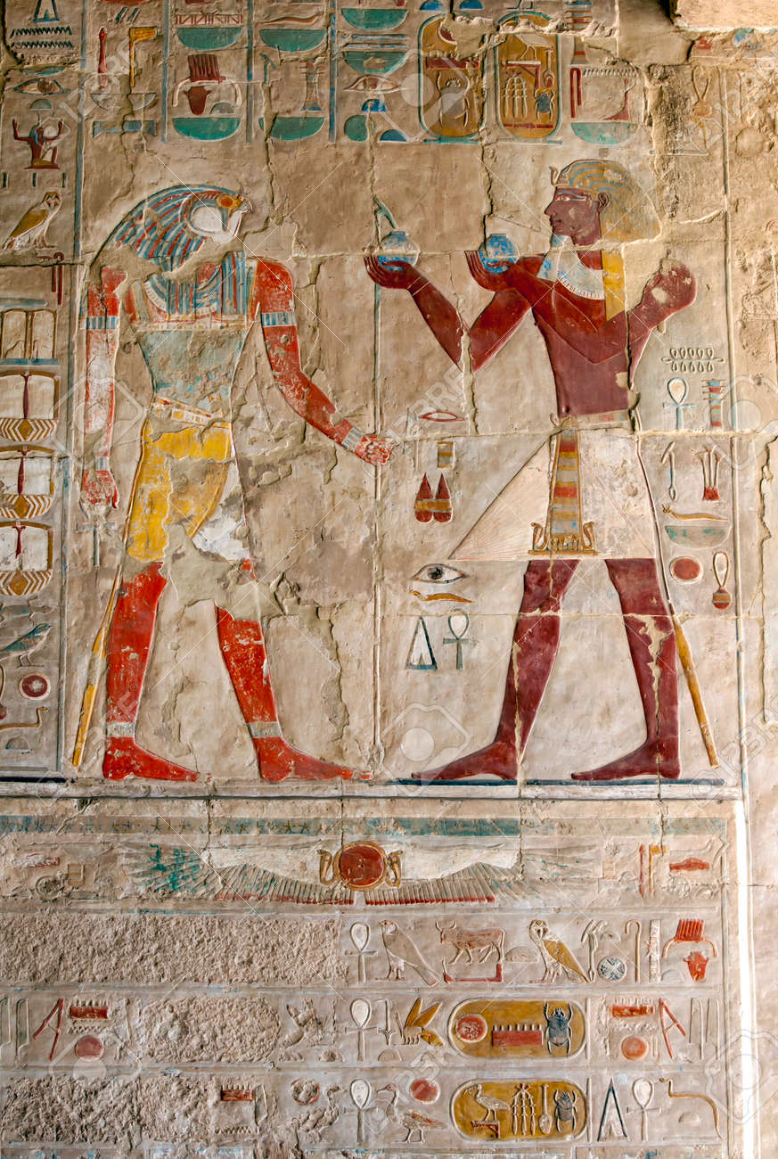 An engraved relief depicting Horus (left) receiving an offering from Thutmose lll at the Mortuary Temple of Hatshepsut at Deir al-Bahri near Luxor in central Egypt. - 172089023