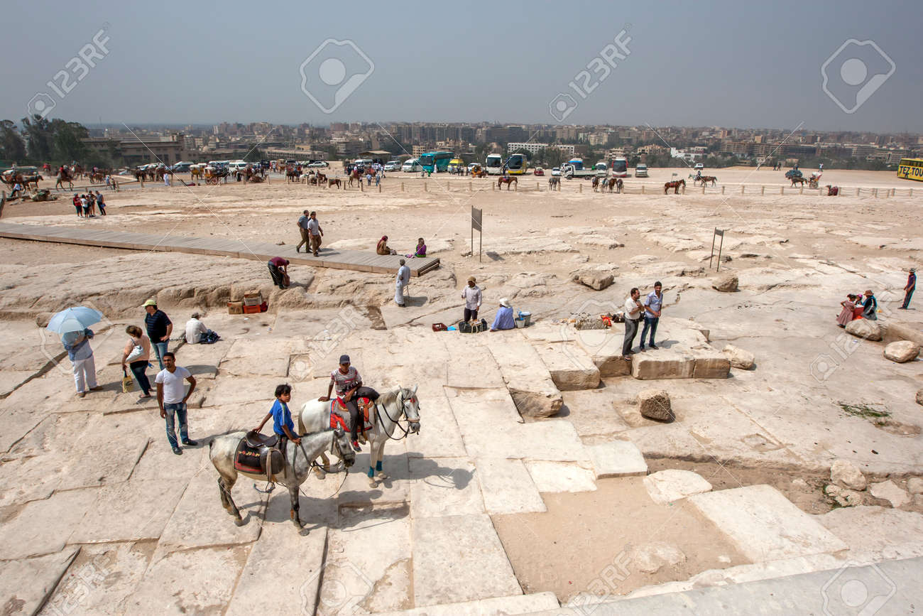 A view from the base of the Pyramid of Khufu on the Giza Plateau looking towards modern Cairo in Egypt. - 172089015