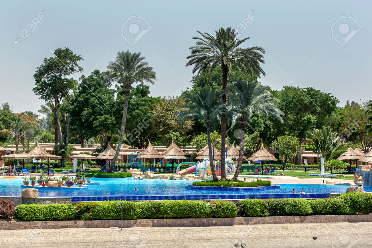 The luxury swimming pool of a hotel complex adjacent to the River Nile at Luxor in Egypt. - 173508733