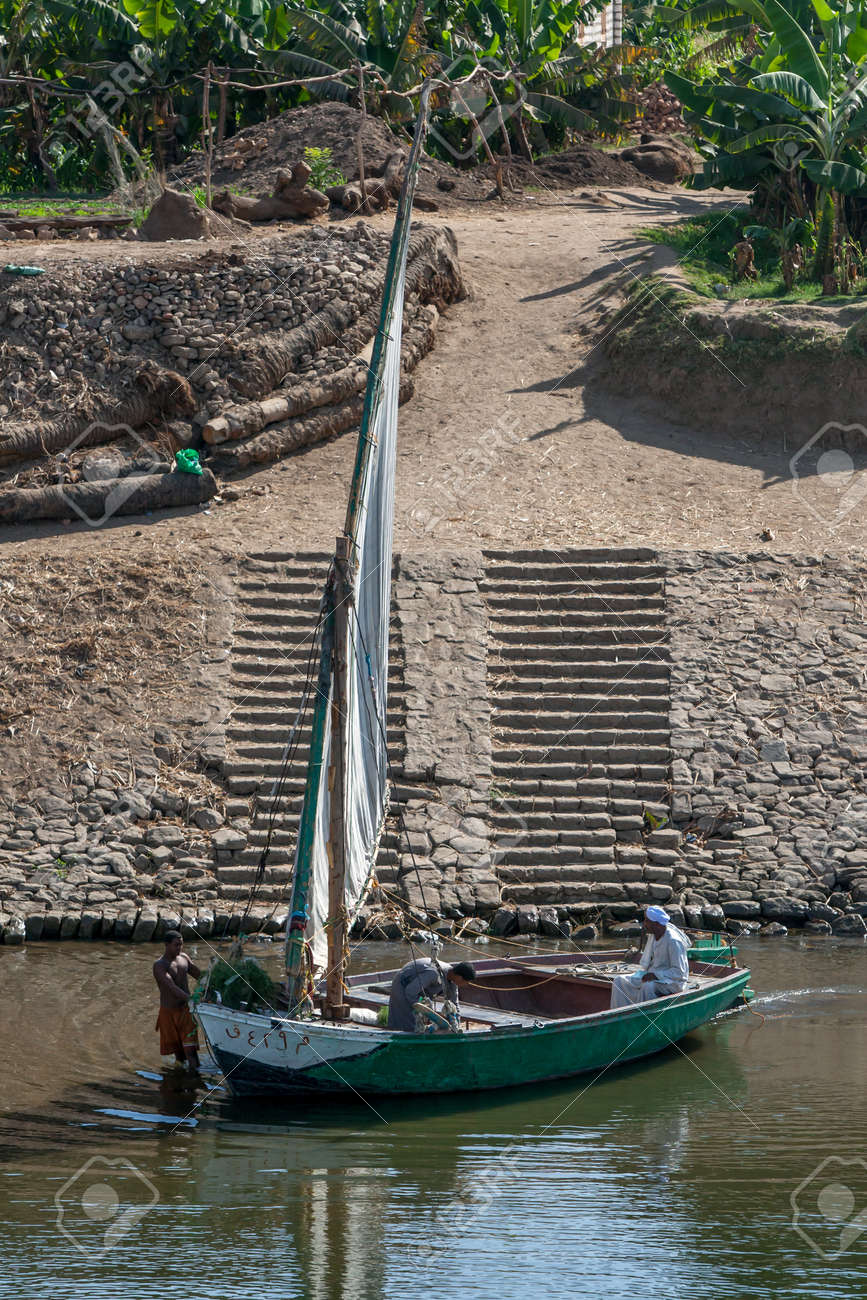 A sailing boat prepares to depart from the bank of the River Nile south of Luxor in Egypt. - 173508740