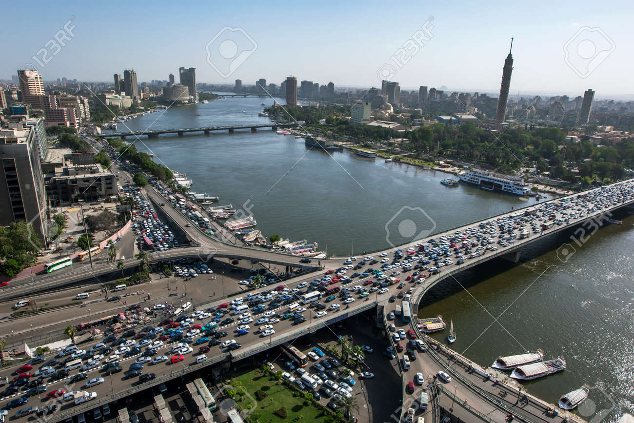 Afternoon peak hour traffic gridlock over the 6th October Bridge which crosses the River Nile at Cairo in Egypt. - 173509890