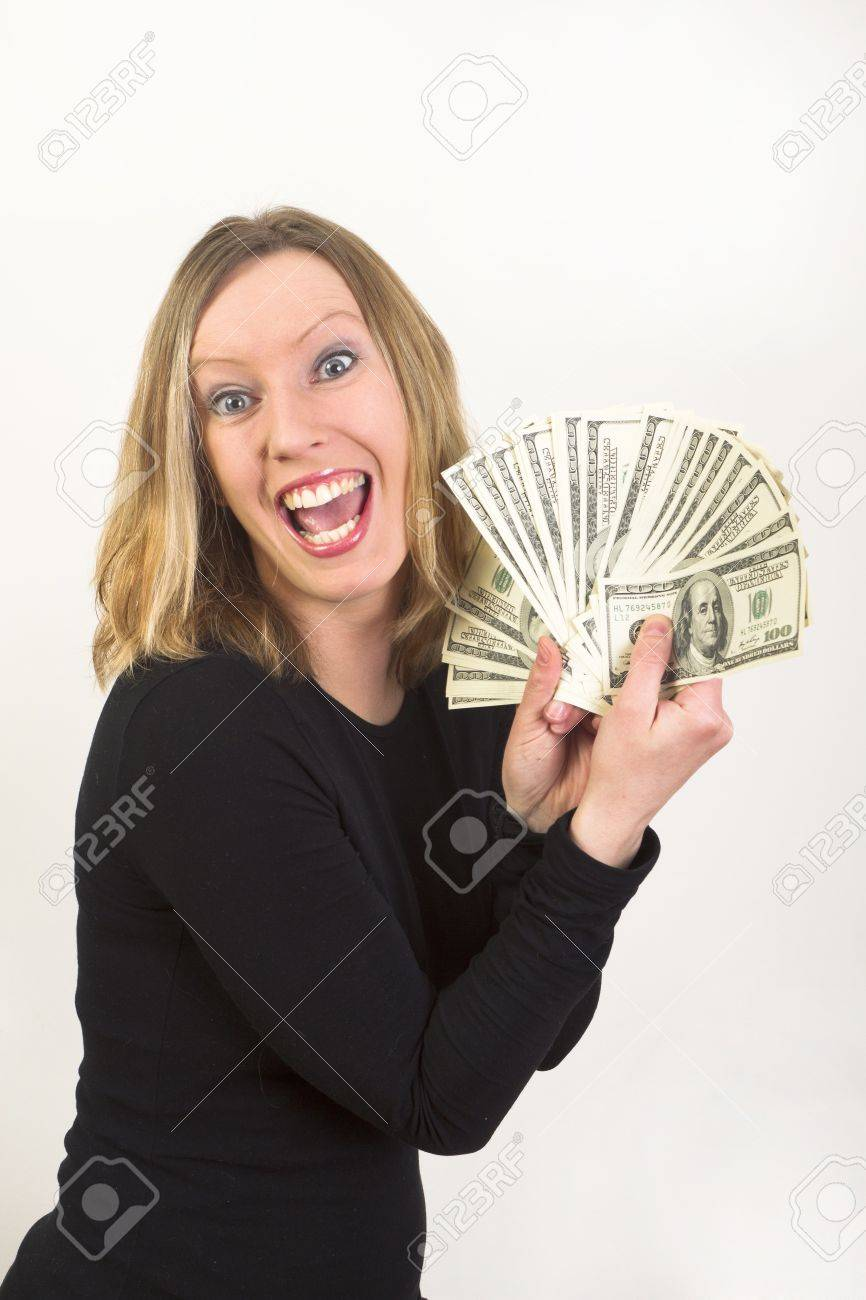 Pretty young woman have lot of US dollars in hundered bills Stock Photo - 9508491