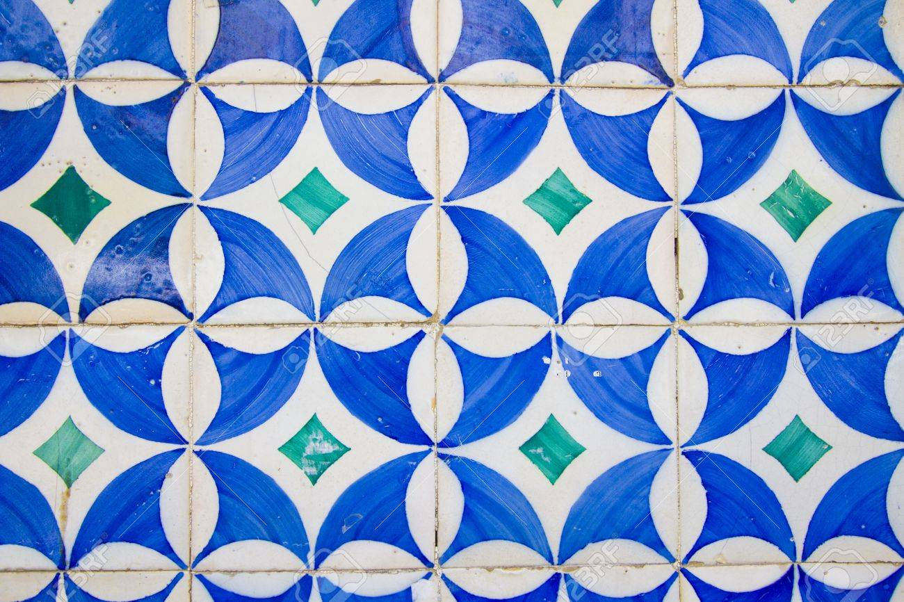 Old white tiles with blue painting Stock Photo - 14290193