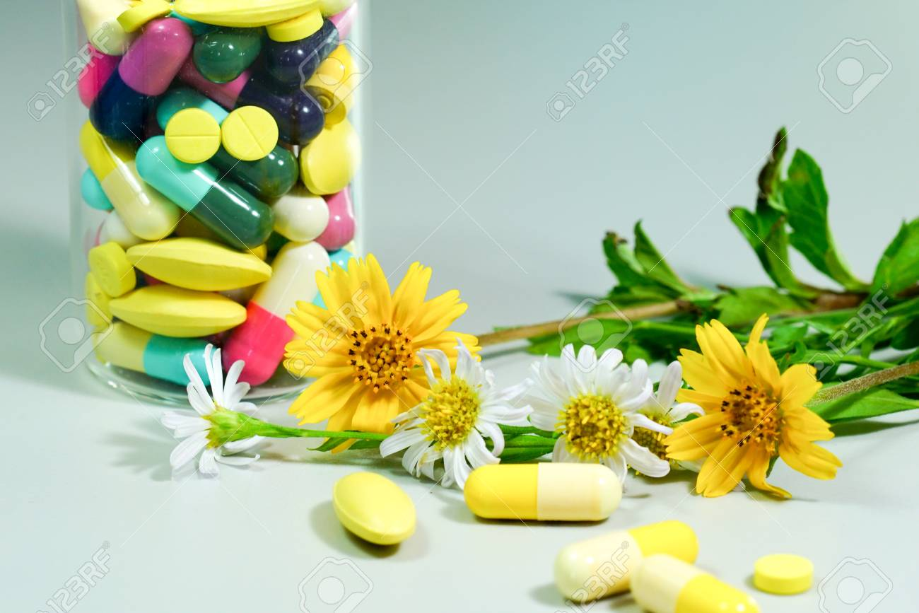 Medicine pills with yellow and white flower stock photo picture medicine pills with yellow and white flower stock photo 83667139 mightylinksfo