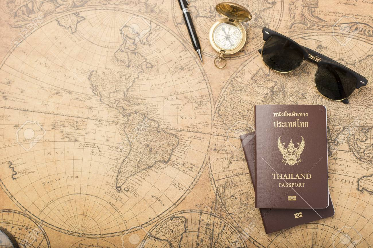planning travel concept thailand passport on old map stock photo