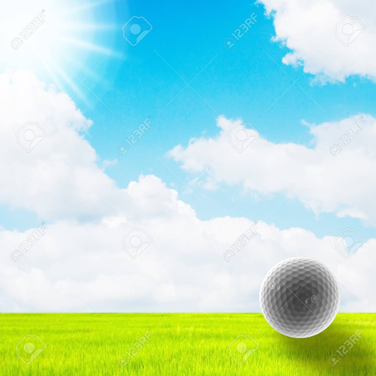 golf ball in green grass on a blue sky and sun Stock Photo - 11871196