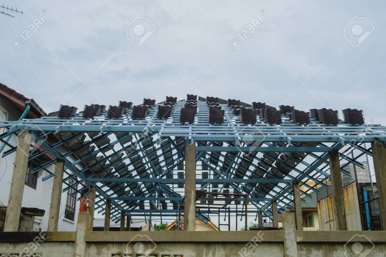 Worker Installing Structure Of Roof Steel For New Building At Stock Photo Picture And Royalty Free Image Image 70169923