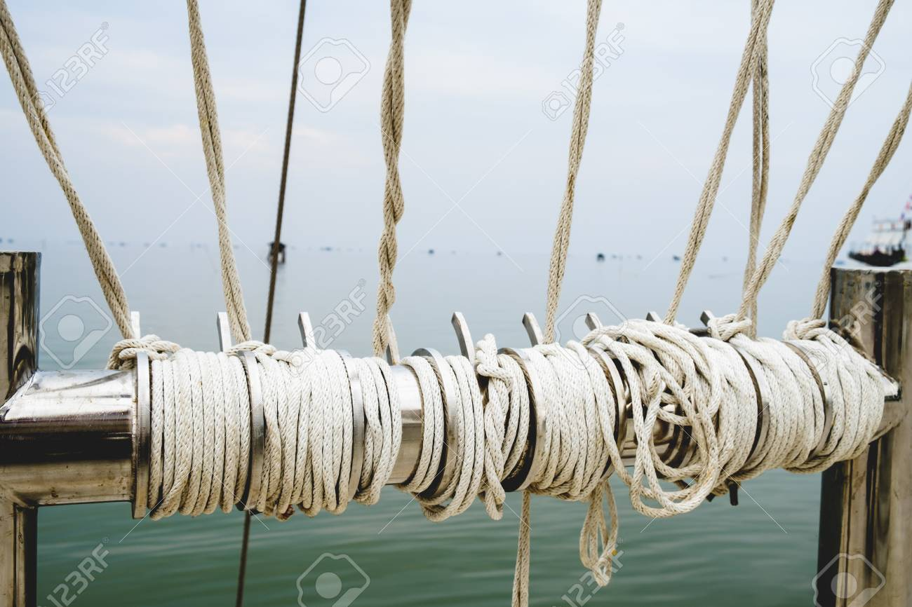 Rope knot on boat sea background as a strong nautical marine rope knot on boat sea background as a strong nautical marine line tied together as a biocorpaavc Choice Image